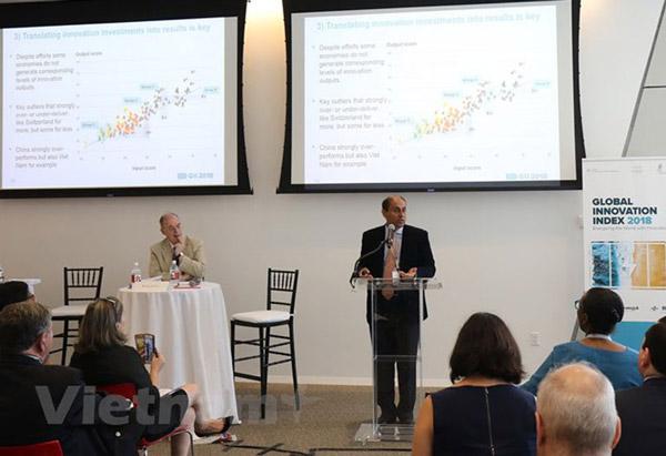 Các diễn giả trình bày đánh giá tại buổi lễ công bố báo cáo - Ảnh: Vietnam+