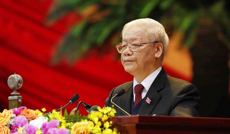 Đồng chí Nguyễn Phú Trọng, Tổng Bí thư Ban Chấp hành Trung ương Đảng, Chủ tịch nước CHXHCN Việt Nam đọc Báo cáo chính trị của Ban Chấp hành Trung ương Đảng khóa XII và các văn kiện trình đại hội